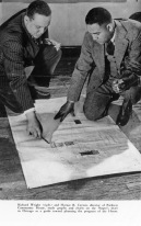 In this photo, Horace Cayton and Richard Wright observe a map of the South Side.